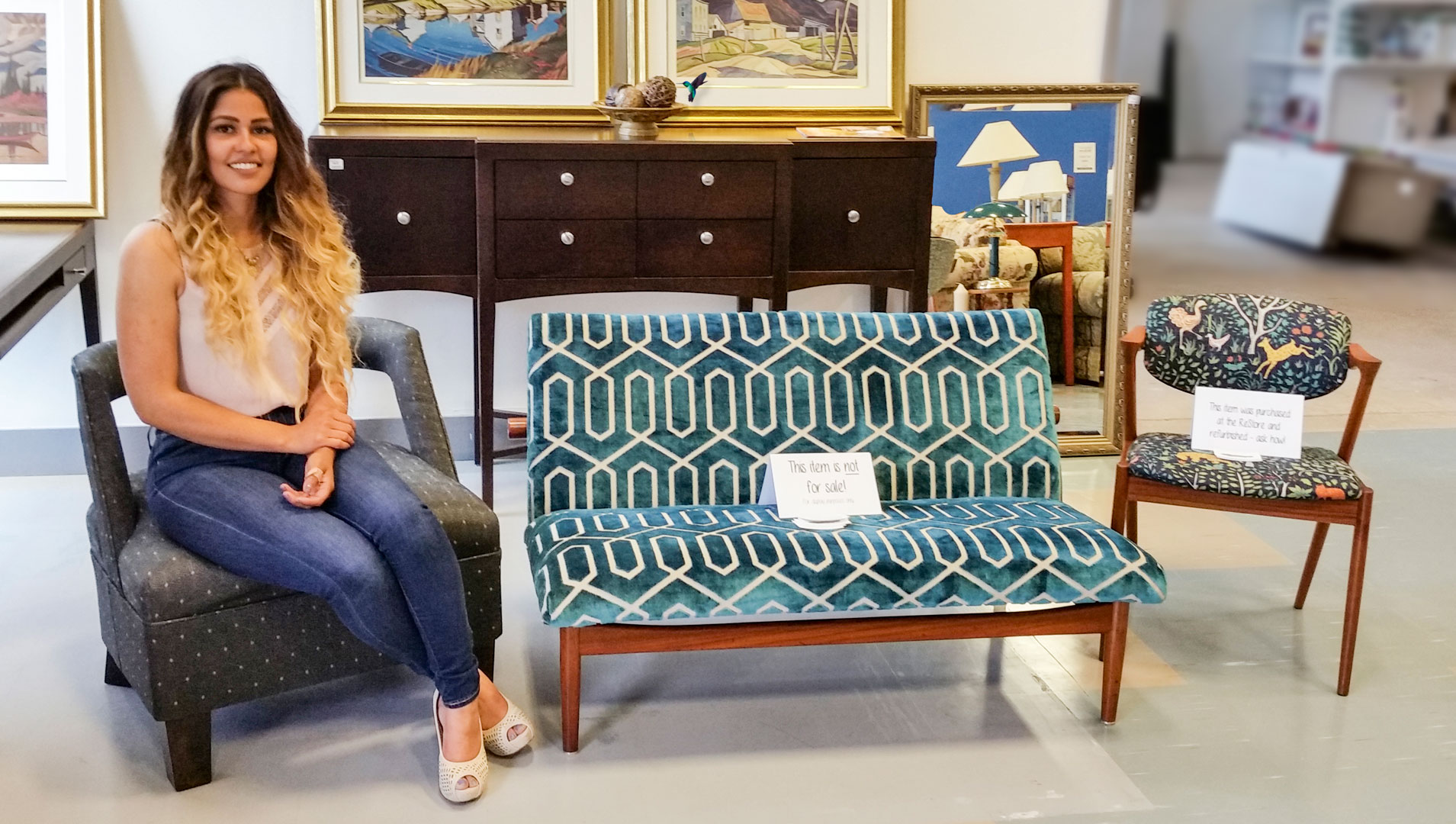 Katherine Cherry presenting her newly upholstered and refinished projects.